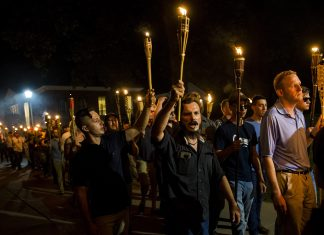 CHARLOTTESVILLE, USA - AUGUST 11: Neo Nazis, Alt-Right, and White Supremacists march through the University